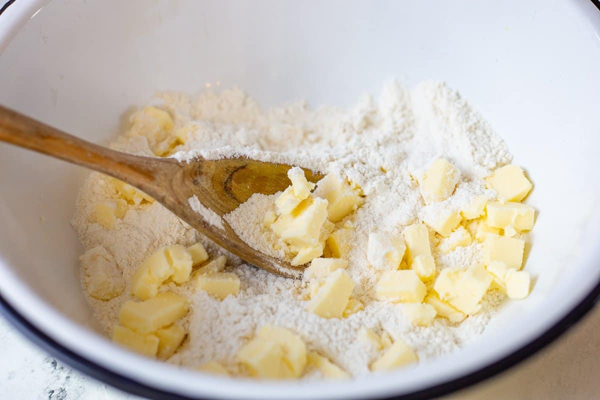 Cubed butter is added to the dry ingredients.