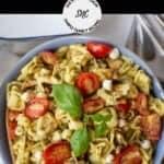 Close up image of caprese pesto pasta salad.
