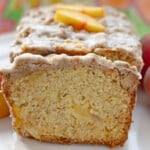 Close up image of peach cobbler pound cake on white plate.