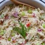 Close up image of tuna and pasta salad in bowl.