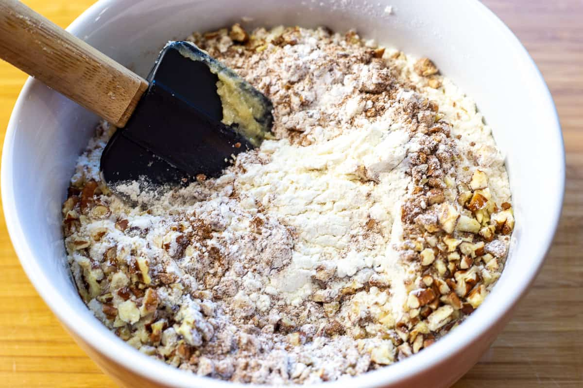 Dry ingredients and ground pecans in mixing bowl.