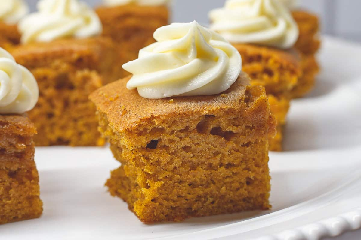 Close up image of Paula Deen's Pumpkin Bars with a rosette of cream cheese frosting.