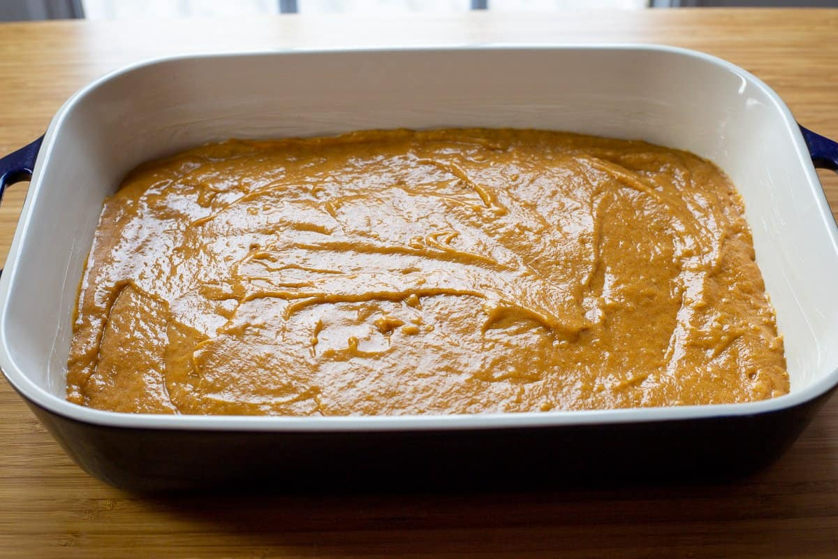 Pumpkin bar batter is spread into a greased 9 x 13 inch baking dish.
