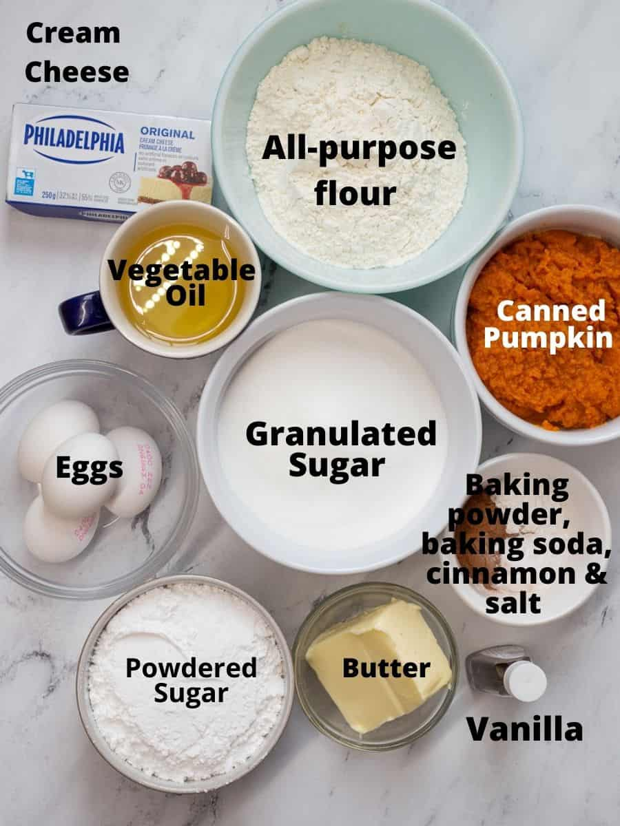 Ingredients for Pumpkin Bar Recipe in small bowls with text overlay on each ingredient.