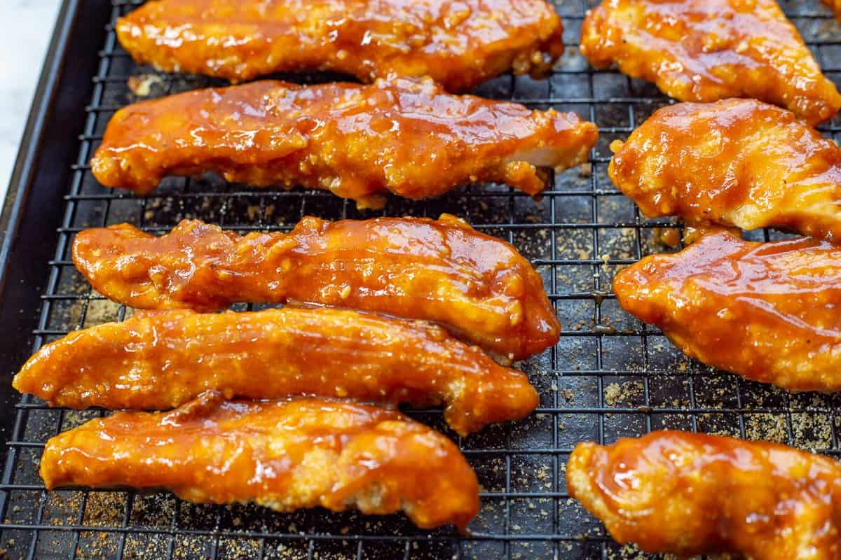 Completed dish of barbecued chicken tenders on baking sheet.